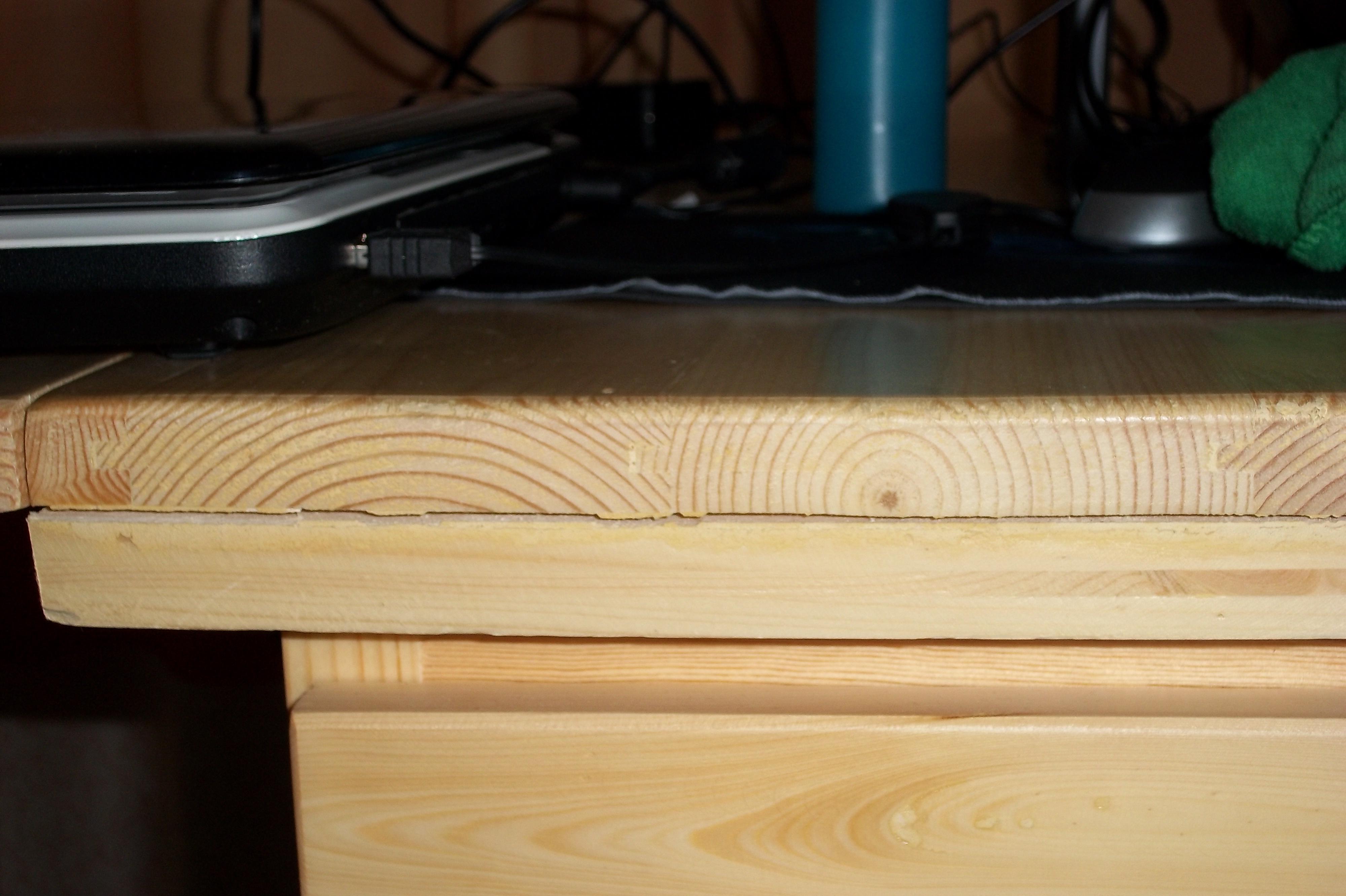 实木餐桌桌面翘边