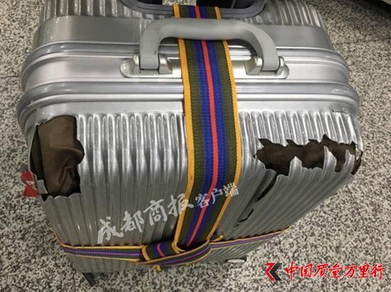 行李箱经国航托运后箱体碎裂 女乘客投诉后获赔300元